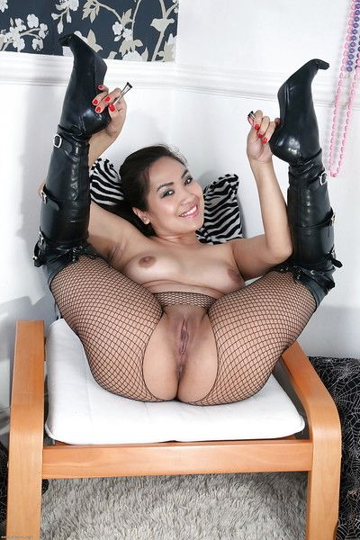 Asian amateur in black boots and fishnets revealing her goods