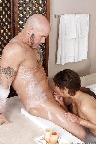 Sultry asian masseuse gives a blowjob and takes a cumshot on her face