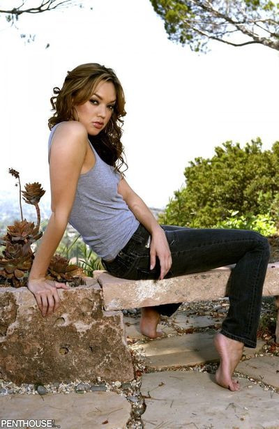 Looking casual in her jeans, Valentina Vaughn strips to show her shapely ass in outdoor posing.