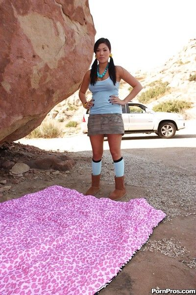 Slant-eyes babe London Keyes shows her shaved coochie outdoors over stone