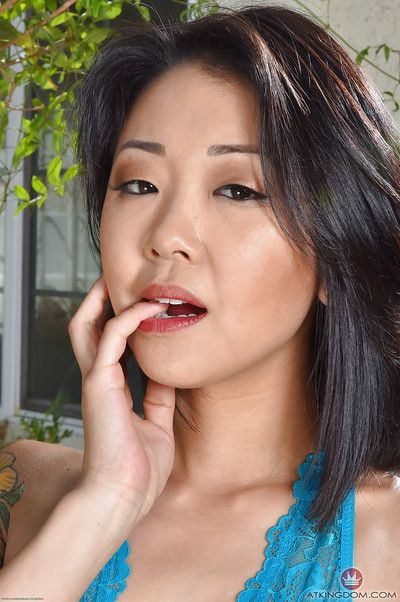 Amateur Asian model Saya Song releasing trimmed cunt from crotchless panties