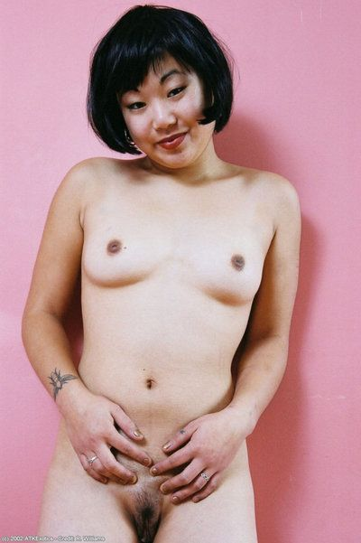 Asian amateur Junko folds back labia lips of hairy cunt after skirt removal