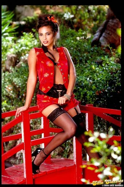 Enchanting oriental hottie Sammy Stone in black stockings does some modeling on the bridge
