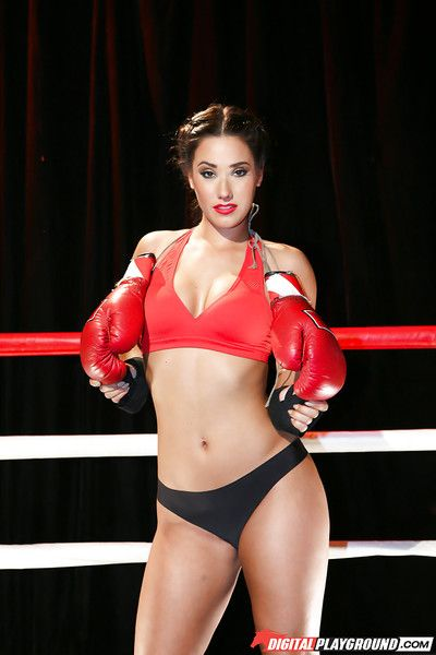Asian pornstar Eva Lovia posing naked in boxing ring wearing black boots