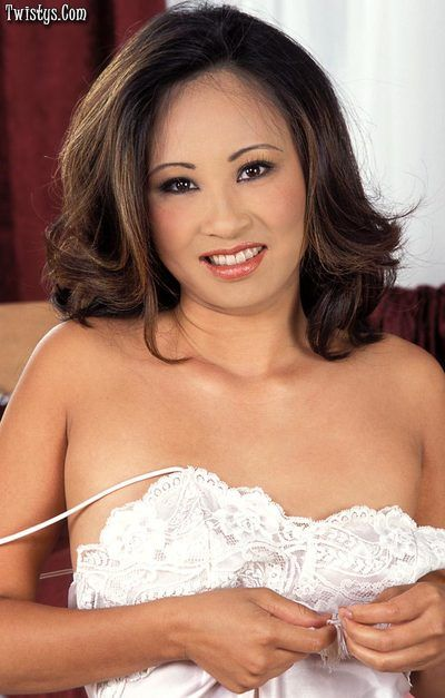 Sexy Asian Lisa Lin lays off her satin slip and enters red toy in her wide shaggy pussy.