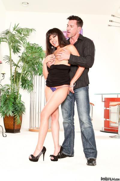 Horny Asian honey Annie Cruz is wearing sexy panties with pleasure while posing.