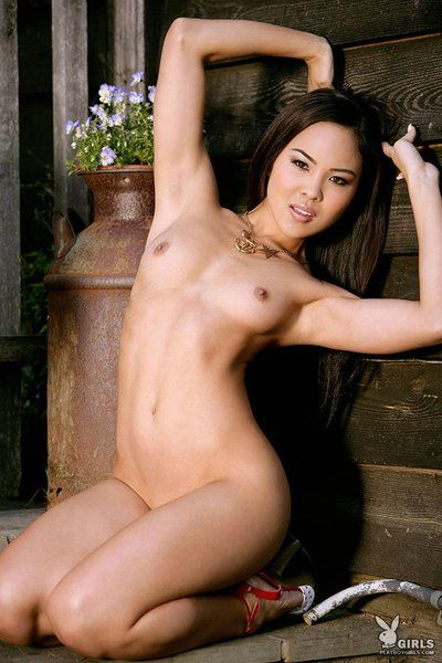 Leggy asian Janine Siu with small firm tits arches her back while stripping naked