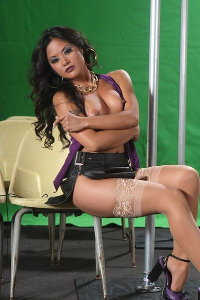 Asian chick in tan stockings Kaylani Lei behaves as sexily as she ever can