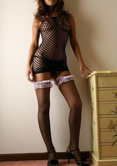 Japanese babe Yoko Yoshikawa is sexily flexing her steaming slender body shape dressed in fishnet stockings
