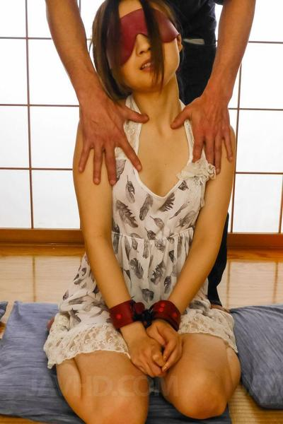 Two naughty fuckers are holding cute Mayuka Akimoto and drilling her nipples and hairy cunt with vibrators