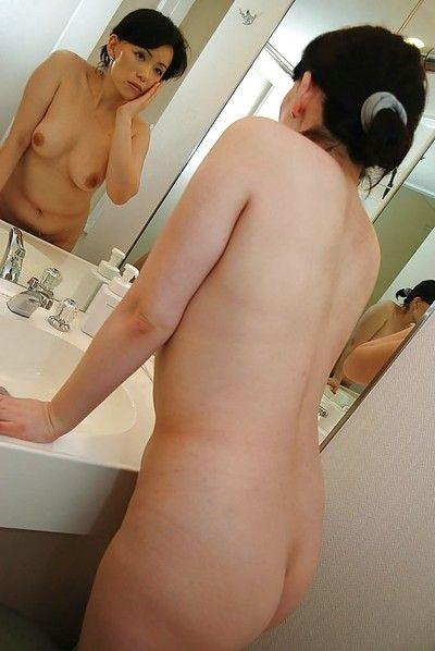 Asian MILF Misuzu Masuko taking shower and teasing her hairy cunt