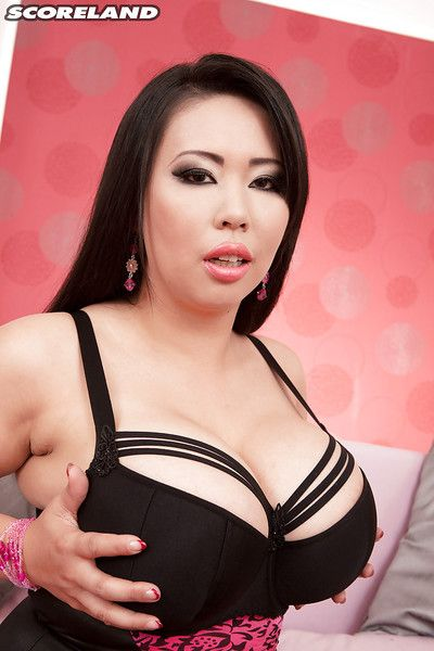 Asian BBW Tigerr Benson flaunts her massive tits and clit piercing