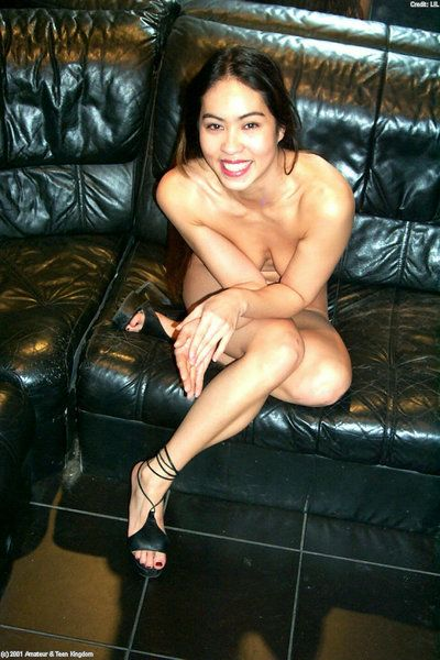 Asian first timer Milla displaying naked ass in high heels and barefeet