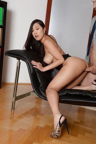 Busty Asian secretary Sharon Lee spreads sleek legs for oral sex