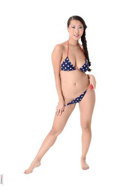 Bikini girl Sharon Lee oils naked boobs and worships her own oriental beaver
