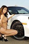 Shiny bikini hot on Asian car model Kt So posing outdoors