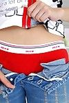 Yui Seto is charmingly undressing on the couch and making to excite by bending in sex poses in red panties