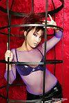 Tight bodied flirtatious asian model Katsumi poses in tight latex mini skirt and naked