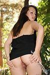 Sexy oriental brunette Callie Dee in black mini dress dildos her exotic snatch