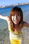 Japanese teen chick Yua Aida is looking extremely hot in her yellow dress and tottaly nude on her large bed