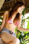 Yua Aida is getting off her red blouse and steamingly posing her nude sexy slender body on the bench outdoors