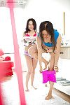 Young Asian girls Janee and Maylin get dressed after girl on girl sex