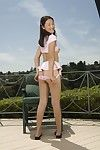 Asian chick Evelyn Lin unbares tits and pussy and finger fucks vagina outdoor