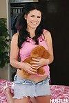 Brunette teen Miranda Kelly in white high heel shoes strips naked beside her teddy bear