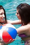 Lesbian pornstars Abella Dangera and Darcie Dolce play with tongue teen love-cages outside
