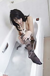 Gorgeous ebony haired Zoe Moore gets wet in the tub wearing ebony stockings