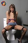 Petite Asian teen Kitty sucks off a cock via a gloryhole in bathroom stall