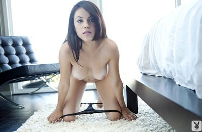 Young slender cutie has fancy tattoos on her body coupled with she stretches in the flesh in a downcast akin
