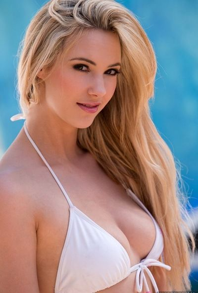 White bikini is perfection on rub-down the body for young model Sophia Paladin outdoors