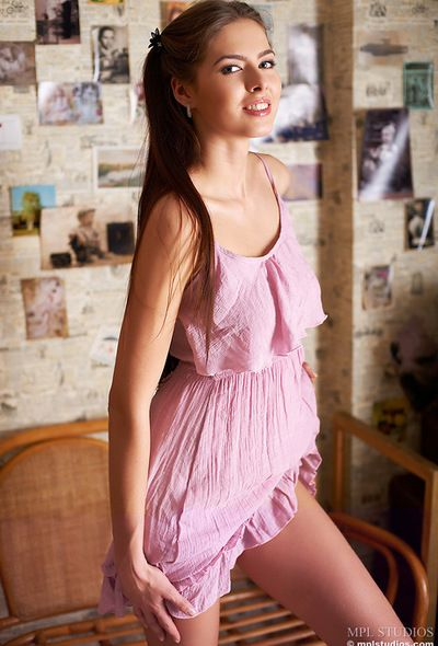 In a pink apparel make an issue of young gloom is mouth watering and happily strips unadorned